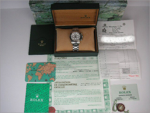 Mens Rolex Zenith steel Daytona box, papers  and sales receipt