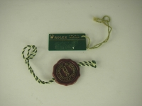 Genuine Rolex Red Holgram and Green Swimpuf Tag!
